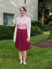 Some people don't mix red and pink, but the darker pinks in the top match the burgundy of the skirt! And even though the florals aren't on the same background color, they coordinate well (Wrap: turban with a pin)